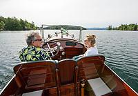 "Dick and Patricia Hopgood take a cruise in their 1910 Goodhue and Hawkins 36' Laker ""Keen Kutter""  around Cow Island on Lake Winnipesaukee, New Hampshire.  ©2018 Karen Bobotas Photographer"