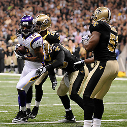 Jan 24, 2010; New Orleans, LA, USA; Minnesota Vikings wide receiver Sidney Rice (18) catches a touchdown past New Orleans Saints cornerback Randall Gay (20) and linebacker Scott Shanle (58) and linebacker Jonathan Vilma (51)during a 31-28 overtime victory by the New Orleans Saints over the Minnesota Vikings in the 2010 NFC Championship game at the Louisiana Superdome. Mandatory Credit: Derick E. Hingle-US PRESSWIRE