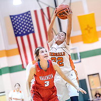 Gallup Bengal Erika Trujillo (32) catches a pass above Valencia Jaguar Raquel Chavez (3) during the Wingate Holiday Classic girls basketball tournament championship game at Wingate High School Saturday.