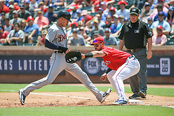 May 9, 2018 - Arlington, TX, U.S. - ARLINGTON, TX - MAY 09: Detroit Tigers outfielder JaCoby Jones (21) returns to the bag to avoid a tag by Texas Rangers first baseman Joey Gallo (13) during the game between the Detroit Tigers and the Texas Rangers on May 9, 2018 at Globe Life Park in Arlington, TX. (Photo by George Walker/Icon Sportswire) (Credit Image: © George Walker/Icon SMI via ZUMA Press)