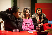 Volunteers Jitka Cervenakova (25, left)  and Denisa Gaborova (middle) Meeting with volunteers for data collection regarding school enrolments in a backroom of a bar in Ostrava.