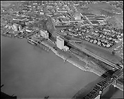 """ackroyd_10075-3.tif. """"Balfour - Guthrie. Aerial Irving Dock. December 2, 1960"""" (Willamette river from the Broadway Bridge north to Albina Engine & Machine.)"""