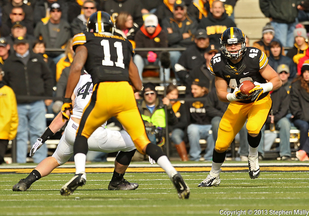 October 26 2013: Iowa Hawkeyes fullback Macon Plewa (42) runs after a reception during the third quarter of the NCAA football game between the Northwestern Wildcats and the Iowa Hawkeyes at Kinnick Stadium in Iowa City, Iowa on October 26, 2013. Iowa defeated Northwestern 17-10 in overtime.