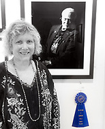 "Manhasset, New York, U.S., September 8, 2019. Ann Parry poses next to her photo ""Buzz Aldrin"" - the 1st Place winner of The Art Guild's ""About Face: The Portrait"" juried competition, at Elderfields. (© 2019 Bob Stuhmer