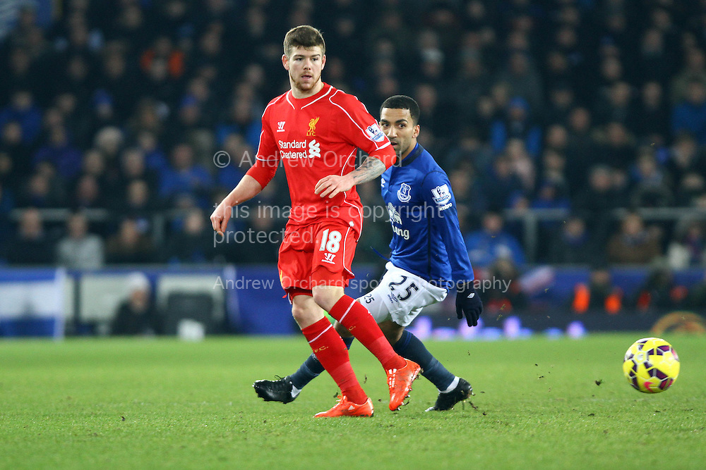 Alberto Moreno of Liverpool passes under pressure from Aaron Lennon of Everton. Barclays Premier league match, Everton v Liverpool at Goodison Park in Liverpool, Merseyside on Saturday 7th February 2015<br /> pic by Chris Stading, Andrew Orchard sports photography.