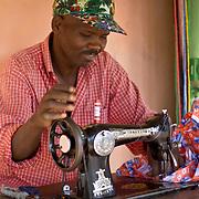 Tailor at the Sunday market. Near Koumbadiouma in Kolda, Senegal.