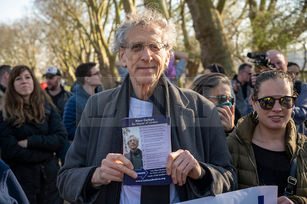 © Licensed to London News Pictures. 27/02/2021. London, UK. PIERS CORBYN makes a speech before being g arrested by police officers at an anti-vaccination and anti-lockdown demonstration in Bishops Park area of Fulham, West London. The group  against the current tier regulations and anti-vaccination for the Covid-19 disease credit: Ray Tang/LNP