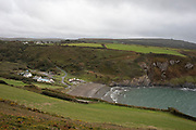 Landscape looking down to Pwllgwaelod Beach and out to sea at Dinas Head near Newport, Pembrokeshire, Wales, United Kingdom.
