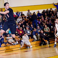 012214  Adron Gardner/Independent<br /> <br /> Crownpoint Eagle Nicholas Chischilly (5), left, floats to the baseline to save a pass in Tohatchi Wednesday