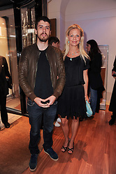 Actor TOBY KEBBELL and ANNABEL WOLOWICZ at a party to celebrate the B.zero 1 design by Anish Kapoor held at Bulgari, 168 New Bond Street, London n 2nd June 2010.
