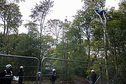 Aylesbury Vale, UK. 5th October, 2020. National Eviction Team (NET) bailiffs monitor Daniel Marc Hooper, better known as environmental activist Swampy, who is occupying a makeshift tree house about sixty feet above ground at a wildlife protection camp in ancient woodland at Jones' Hill Wood. The Jones' Hill Wood camp, one of several protest camps set up by anti-HS2 activists along the route of the £106bn HS2 high-speed rail link in order to resist the controversial infrastructure project, is currently being evicted by National Eviction Team bailiffs working on behalf of HS2 Ltd.