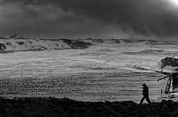 Man walking in a heavy storm at the harbour in Grimsey, which is island, north of Iceland / Gangandi maður í stormi, skammt við höfnina i Grímsey
