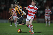 Matthew Kennedy (Port Vale) tackled by Craig Alcock (Doncaster Rovers) unfairly and the referee gives a free kick during the Sky Bet League 1 match between Doncaster Rovers and Port Vale at the Keepmoat Stadium, Doncaster, England on 26 January 2016. Photo by Mark P Doherty.