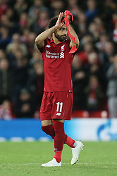 Liverpool's Mohamed Salah (left) acknowledges the fans as he is substituted off as Liverpool's Adam Lallana walks behind