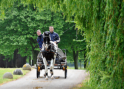 © under license to London News Pictures. LONDON, UK  11/05/2011. Riders put their horses through early morning exercise before entering the parade ring. The first day of The Royal Windsor Horse Show in the private grounds of Windsor Castle today (11 May 2011). Photo credit should read Stephen Simpson/LNP.
