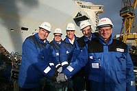 Oasis of the Seas. Float Out, Turku, Finland..Royal Caribbean's Oasis of the Seas the worlds largest cruise ship, enters final construction phase  at STX ship yard in Finland..Wheel turning to flood the dry dock..L-R   Richard Fain (Chairman and CEO Royal Caribbean) Harri Kulovaara (Senior VP Marine Royal Caribbean)Captain William Wright (SVP Marine) Martin Landtman (President, STX Finland Cruise) Toivo Ilvonen (Project Director Oasis Class)