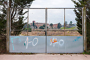 """""""1-O"""" graffiti- referring to the October 1st 2017 Catalan independence referendum, which went ahead, despite violent crackdowns by Spanish police against voters. Photographed Sant Cugat del Valles, Barcelona, Catalonia. Spanish flag sticker has been partly scraped off the gate."""