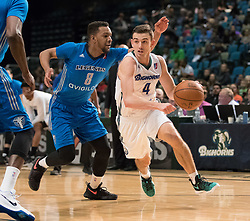 March 20, 2017 - Reno, Nevada, U.S - Reno Bighorn Guard DAVID STOCKTON (4) drives against Texas Legends Guard BRYSON FONVILLE (8) during the NBA D-League Basketball game between the Reno Bighorns and the Texas Legends at the Reno Events Center in Reno, Nevada. (Credit Image: © Jeff Mulvihill via ZUMA Wire)