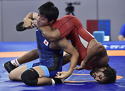JAKARTA, Aug. 19, 2018  Bajrang Bajrang (R) of India vies with Takatani Daichi of Japan during Men's Wrestling Freestyle 65 kg Final of the 18th Asian Games at Jakarta, Indonesia, Aug. 19, 2018. (Credit Image: © Li He/Xinhua via ZUMA Wire)
