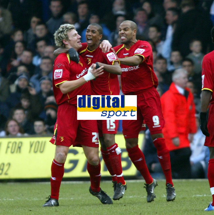 Photo: Chris Ratcliffe.<br />Luton Town v Watford. Coca Cola Championship.<br />02/01/2006.<br />Darius Henderson (L) celebrates his opening goal with Ashley Young (C) and Marlon King.