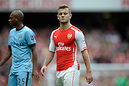 Arsenal's Jack Wilshere looks on. Barclays Premier league match, Arsenal v Manchester city at the Emirates Stadium in London on Saturday 13th Sept 2014.<br /> pic by John Patrick Fletcher, Andrew Orchard sports photography.