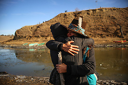November 25, 2016 - Cannon Ball, North Dakota, U.S - KARINA PETRI (left) of Project Flint is hugged by TEMRYSS XELI'TIA LANE (right) of the Lummi Nation in Northwest Washington after a woman criticized indigenous culture and strategy near the Oceti Sakowin Camp at the Standing Rock Indian Reservation in Cannon Ball, North Dakota. (Credit Image: © Joel Angel Ju‡Rez via ZUMA Wire)