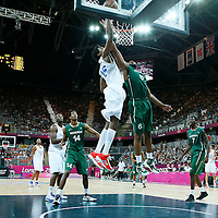 06 August 2012: France Mickael Gelabale goes for the offensive rebound over Nigeria Ike Diogu during 79-73 Team France victory over Team Nigeria, during the men's basketball preliminary, at the Basketball Arena, in London, Great Britain.