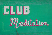 Sign advertising the Club Meditation nightclub along the King's Highway in Alice Town on the tiny Caribbean island of Bimini, Bahamas.