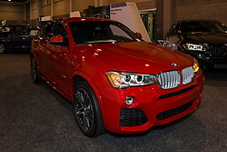 CHARLOTTE, NORTH CAROLINA - NOVEMBER 20, 2014: BMW X4 sports activity vehicle on display during the 2014 Charlotte International Auto Show at the Charlotte Convention Center.