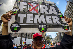 June 30, 2017 - Sao Paolo, Brazil - Members of the Roofless Movement call for Brazilian President Michel Temer to step down and protest against his proposed economic reforms, at Paulista Avenue. Demonstrators in major Brazilian cities snarled rush hour traffic on June 30 to protest austerity measures introduced by embattled President Michel Temer. (Credit Image: © Cris Faga via ZUMA Wire)