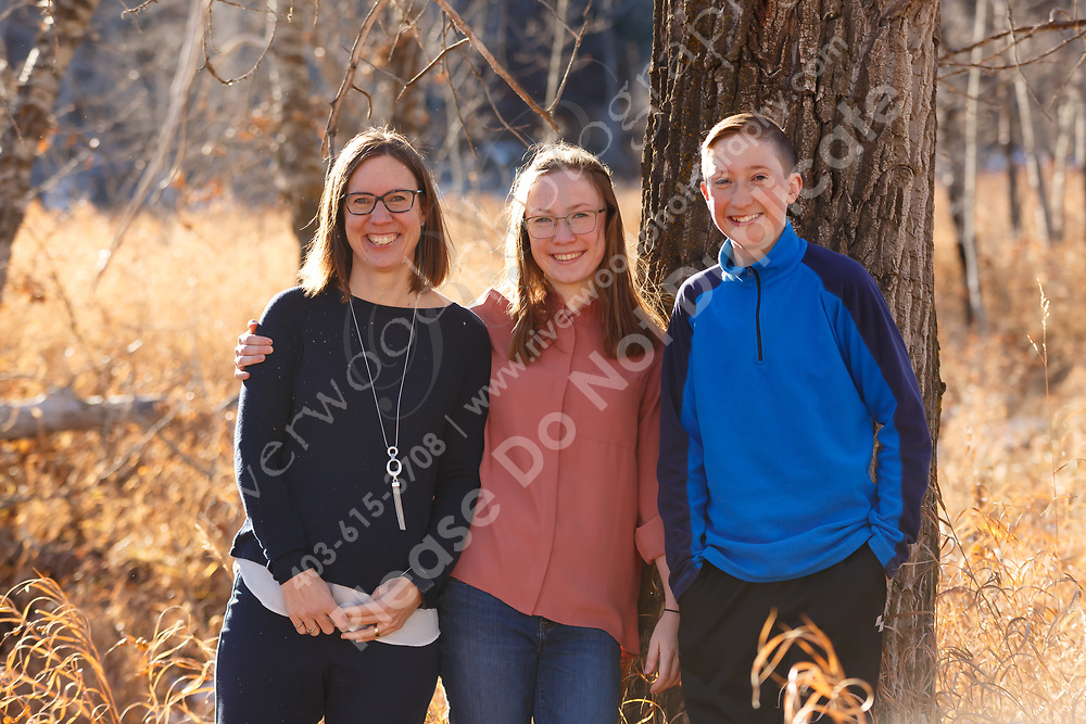 Outdoor fall family portraits near the Bow Valley Ranche in Fish Creek Provincial Park in SE Calgary<br /> <br /> ©2020, Sean Phillips<br /> http://www.RiverwoodPhotography.com