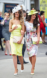 LIVERPOOL, ENGLAND - Friday, April 4, 2014: Racegoer during Ladies' Day on Day Two of the Aintree Grand National Festival at Aintree Racecourse. (Pic by David Rawcliffe/Propaganda)