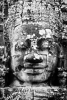 One of the smiling stone faces at The Bayon temple in the walled city of Angkor Thom, Siem Reap, Cambodia