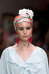July 3, 2018 - Berlin, Germany - A model runs the runway during the Marc Cain Spring/Summer 2019 Fashion Show at Westhafen in Berlin, Germany on July 3, 2018. (Credit Image: © Emmanuele Contini/NurPhoto via ZUMA Press)
