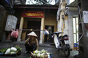 "Hanoi, Vietnam. March 11th 2007..A street scene in ""Pho Co"", the old quarter of Hanoi."