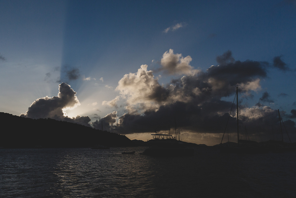 Sunlight blasting from behind the clouds on an evening on Norman Island in the BVI's.