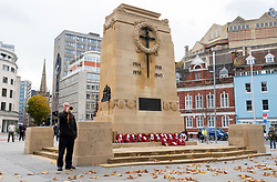 "© Licensed to London News Pictures; 11/11/2020; Bristol, UK. Remembrance Day at the Bristol Cenotaph in the city centre. ALLAN MARSH from Bristol and retired from the Fire Service, plays the tune of the Last Post on his bugle in memory of his father. The normal large military parade and civic procession was cancelled due to the national lockdown restrictions for the Covid-19 coronavirus pandemic, but around 40 people gathered for the two-minute silence that traditionally takes place at 11.00am, recognising the precise time that the hostilities ceased in 1918 – the 11th hour of the 11th day of the 11th month. ALLAN MARSH (contact details available), from Bristol and retired from the Fire Service, plays the tune of the Last Post on his bugle at the Cenotaph in memory of his father Colour Sergeant Arthur Henry Marsh (1908 - 1976) who served during World War Two in the 10th Battalion of the Gloucestershire Regiment in Burma, Malaya, Singapore and India. The Fourteenth Army 1942 -1945 was known as the ""Forgotten Army"". Having defeated the Japanese invasion of India in 1944 they fought on after the war in Europe ended to liberate Burma (now Myanmar) in 1945. The Fourteenth Army was the British army's most diverse and multicultural army with many faiths and nationalities including Gurkhas and Sikh soldiers fighting for the UK against Japan. It was led by Field Marshal Sir William Slim who was born in Bristol. Photo credit: Simon Chapman/LNP."