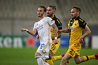 ATHENS, GREECE - OCTOBER 29: James Maddisonof Leicester City attacks in front of Michalis Bakakisof AEK Athens during the UEFA Europa League Group G stage match between AEK Athens and Leicester City at Athens Olympic Stadium on October 29, 2020 in Athens, Greece. (Photo by MB Media)