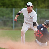 25 April 2010: Nicolas Dubaut of the PUC eyes the ball as Joris Bert of Rouen slides safely at second base during game 2/week 3 of the French Elite season won 12-0 by Rouen over the PUC, at the Pershing Stadium in Vincennes, near Paris, France.