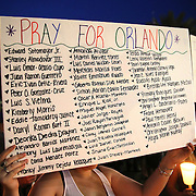 A sign naming victims is seen during a vigil at the Dr. Phillips Center for the Performing Arts for the victims of a mass shooting at the Pulse nightclub Monday, June 13, 2016, in Orlando, Florida.  A gunman killed dozens of people in a massacre at the crowded gay nightclub in Orlando on Sunday, making it the deadliest mass shooting in modern U.S. history. (Alex Menendez via AP)