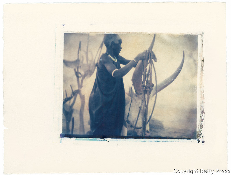 Dinka Woman tending cattle, South Sudan<br /> Image size 4x5, Matted 12x10 Edition of 25 <br /> Archival Pigment Print