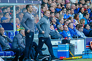 Interim Celtic Manager Neil Lennon rises from the dugout during the Ladbrokes Scottish Premiership match between Rangers and Celtic at Ibrox, Glasgow, Scotland on 12 May 2019.