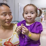 CAPTION: Keren Mijango is now two and a half years old. She was born with a complete unilateral cleft lip on the left side. Thanks to Smile Train, she underwent surgery to correct this at Hospital Escuela in Tegucigalpa in July 2012. In February 2014, the surgeons here performed another operation to repair her cleft palate. These operations were not easy, but the doctors had more tissue to work with in her upper lip area, enabling the surgeons to achieve a result that they can feel very proud of. LOCATION: Hospital Escuela, Tegucigalpa, Honduras. INDIVIDUAL(S) PHOTOGRAPHED: Maria Isabel Iriarte Hernandez (left) and Keren Sarahi Mijango Iriarte (right).