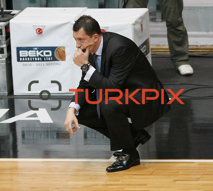 Efes Pilsen's coach Ufuk SARICA during their Turkish Basketball league derby match Besiktas between Efes Pilsen at the BJK Akatlar Arena in Istanbul Turkey on Saturday 30 April 2011. Photo by TURKPIX