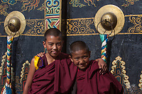 """Two novice monks at Ganzi Monastery, Ganzi, Sichuan Province, China.<br /> Available as Fine Art Print in the following sizes:<br /> 08""""x12""""US$   100.00<br /> 10""""x15""""US$ 150.00<br /> 12""""x18""""US$ 200.00<br /> 16""""x24""""US$ 300.00<br /> 20""""x30""""US$ 500.00"""