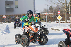 Children riding quadbike