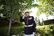 Gunnery Sergeant and former Milpitas Mayor Denny Weisgerber performs Taps during the Memorial Day Ceremony at Milpitas City Hall's Veterans Plaza in Milpitas, California, on May 26, 2014. (Stan Olszewski/SOSKIphoto)