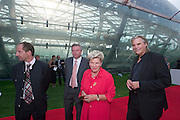 "Waltraud Klasnic (red skirt, Governor of Styria) with Peter Simonischek (""Jedermann"").Hangar-7, the spectacular new home of the Flying Bulls (""Red Bull"" owner Didi Mateschitz' collection of classic airplanes), opens with aeronautical highlights like Karlheinz Stockhausen's ""Helicopter String Quartet"", a production of the Salzburg Festival, and ""Taurus Rubens"", a spectacular Theater for Flying Machines."