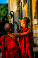 Young novice monks outside the Batataung Pagoda, Yangon (Rangoon), Myanmar (Burma)