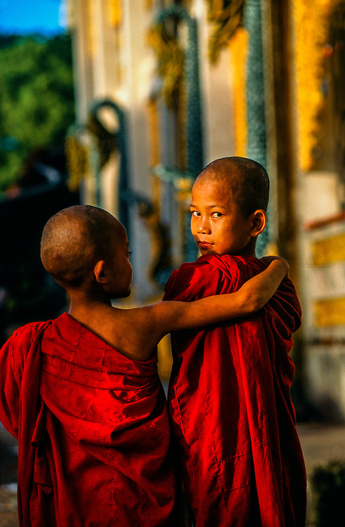 Young novice monks outside the Batataung Pagoda, Yangon (Rangoon), Myanmar (Burma)